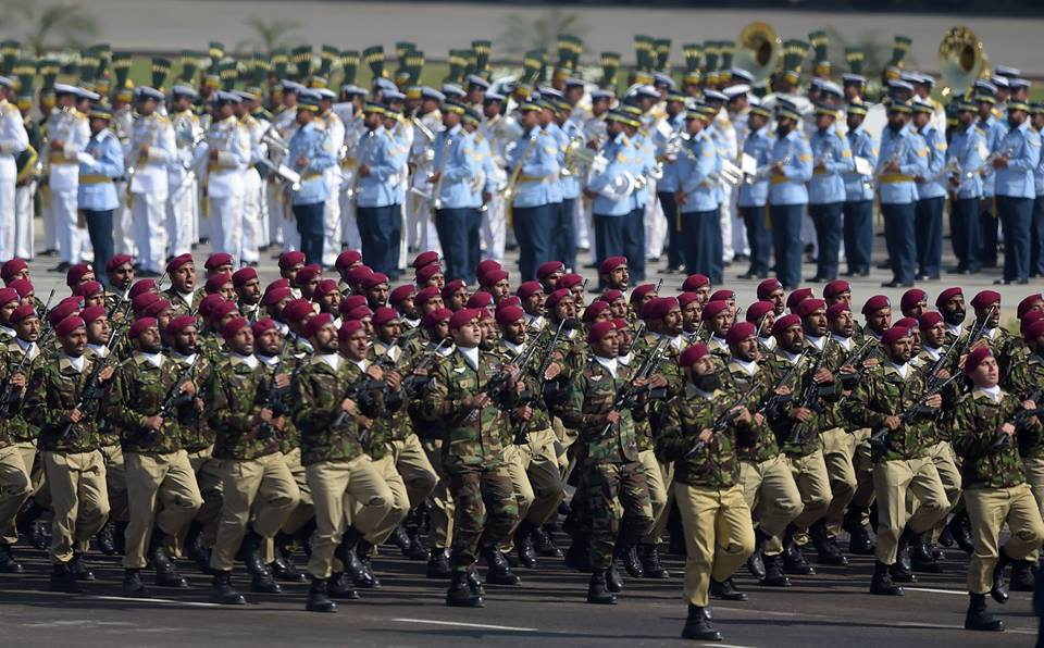 13 - Pakistani troops from the Special Services Group SSG march during Pakistan Day Military Parade