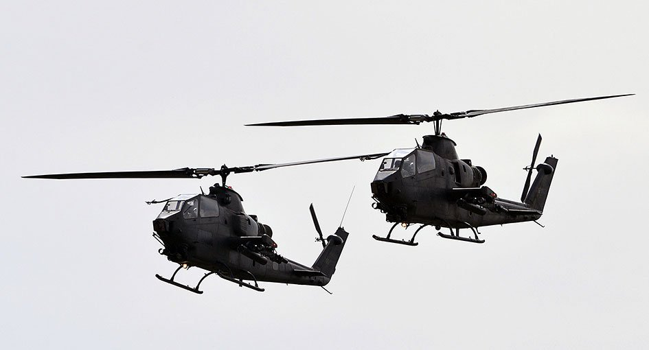 35 - Cobra helicopters fly past during the Pakistan Day military parade in Islamabad on March