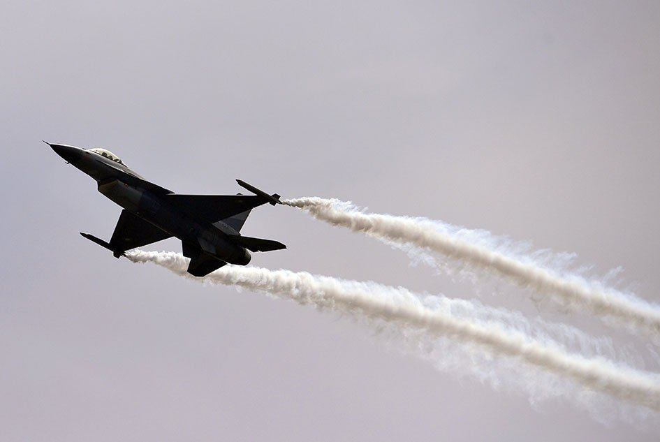 45 - An F-16 fighter performs a flypast during the Pakistan Day military parade in Islamabad
