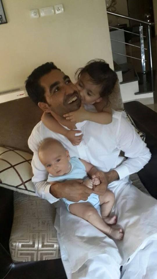 Umar Gul with his kids