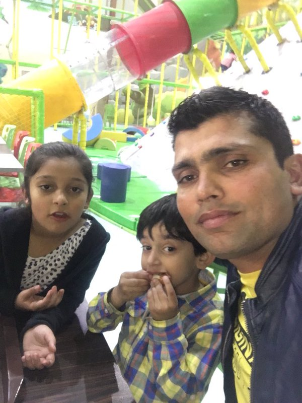 Kamran Akmal with his kids