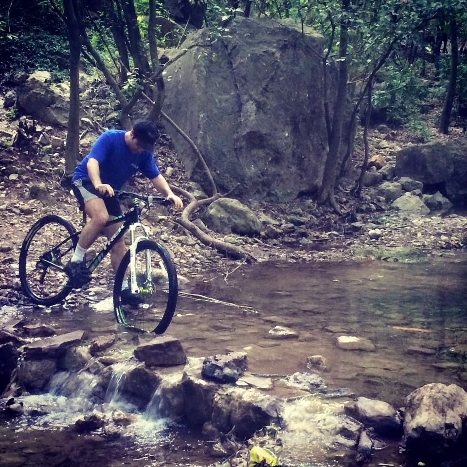 6 - Haroon Crossing a stream while cycling in the beautiful trails of Margalla Hills