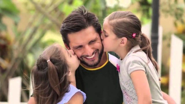 Afridi with his daughters