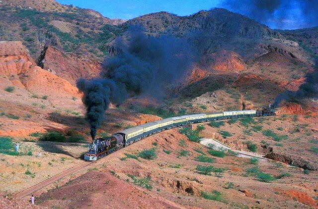 22 - Pakistan Railways train with dual steam locomotives passing between Dandot and Malikwal in the Salt Range.