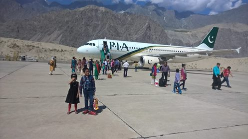 15 - Tourists getting off the plane at the Skardu Airport